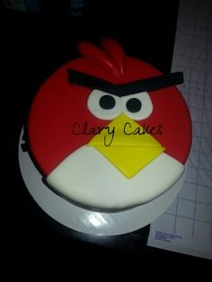 Angry Birds cake covered in Marshmallow red, yellow and white fondant. Black fondant is Satin Ice.