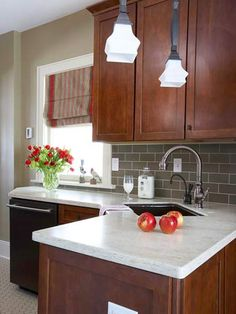 How to Stain Kitchen Cabinets. I really like this color combination. Gray tiles light counter tops.