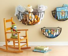 Wall baskets are the perfect place to store stuffed animals, books, and toys yet make for easy access.  Image via Attempting Aloha