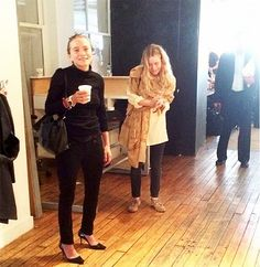 Mary-Kate and Ashley Olsen sip on coffee at The Row S/S 15 show during NYFW