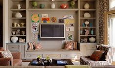 family room with built-in shelving, bench and flat-screen // Jay Jeffers Design Group