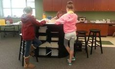 Girls standing in Lisa Puckett's classroom in the Cherry Creek school district. article about alternative seating