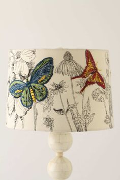 Embroidered Butterfly lampshade. Link broken. Find a black and white fabric, embroider select images, apply to lampshade (several links on how to make your own lampshade.)