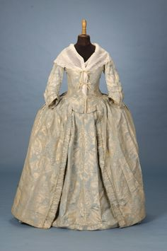 Brocaded Damask Robe a l' anglaise c. 1750, England, blue and ivory damask is brocaded on only about half of the flowers and foliage. The three-dimensional effect makes the design seem to move with the wearer. Trousseau - Fine Antique Fashion