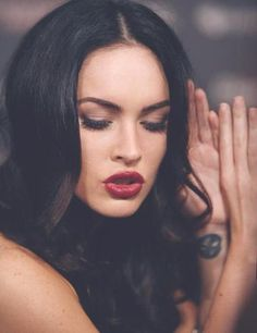 Dark hair and red lips