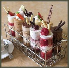 Dessert Shooters ~ Strawberry Shortcake In a Glass, Tiramisu Dessert Shooter, Banana Pudding Dessert Shooter, Coconut Cream Pie Dessert Shooter & Chocolate Kiss Goodnight.... Delightful :)
