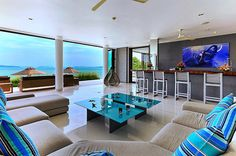 Enjoy intimate gathering with families or friends at this lounging areas (indoor and outdoor) with fully-stocked bar exclusively available for your group's private use at Villa Ocean's 11 in Phuket, Thailand. http://www.theluxurylisting.com/villa-oceans-11-phuket/