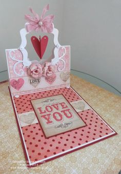 Emma Williams with a Spinner Easel Card that was featured in a magazine! - That's Life: Love Is All Around... Easel Spinner Card