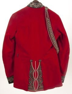 BRITISH VICTORIAN MILITARY DRESS UNIFORM -- A BRITISH VICTORIAN MILITARY DRESS TUNIC AND TROUSERS, circa 1890. Red wool with black collar and cuffs heavily embroidered with silver bullion oak leaf motifs and Tudor rose collar badges, and white piping. Silvered buttons embossed with Queen's crown. Together with a bullion and red mixed cord aiguillette. Complete with black wool trousers with brocade stripes.