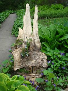 30 DIY Ideas How To Make Fairy Garden - Love the tiny door at the base of the stump!