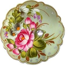 Old Russian folk handicraft of painting on metal trays, which still exists in a village of Zhostovo .: