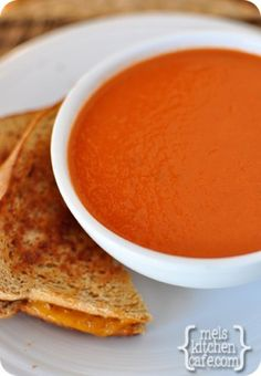 melskitchencafe.com: Classic Tomato Soup 2 (28-ounces each) cans diced tomatoes 3/4 cup low-sodium chicken broth 3 tablespoons butter 1 onion, chopped 1 bay leaf 1 teaspoon brown sugar 2 tablespoons tomato paste 2 tablespoons all-purpose flour 1/2 teaspoon baking soda (cuts the acidity of the tomatoes) Salt and pepper 1/2 cup heavy cream or fat free half-and-half