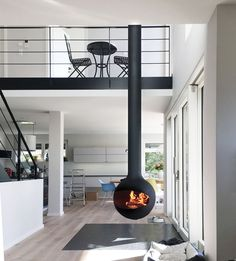 Modern Gas Fireplace Gallery - European Home Suspended Fireplace, Hanging Fireplace, Home Fireplace, Focus Fireplaces, Contemporary Gas Fireplace, Fireplace Gallery, Casa Loft, European House, Loft Style