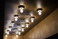 Exposed conduit ceiling lights