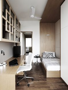 A study desk fitted within the bedroom. The ceiling feature helps to define the sleeping quarters.