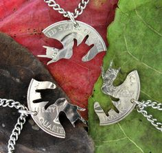 OMG! Yes! ASL ILY interlocking necklaces hand-cut from a quarter. Perfect for a set of three friends. ;)