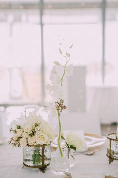 small vases with ivory/champagne colour flowers