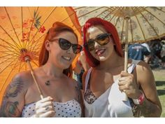 Rockabilly Groove: Fans enjoy some parasol shade at the Hootenanny festival at Oak Canyon Ranch in Irvine, July 7, 2012. PHOTO BY DAVID HALL, FOR THE ORANGE COUNTY REGISTER