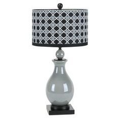 """Grey ceramic table lamp with lattice drum shade.  Product: Table lamp  Construction Material: Ceramic and fabric Color: Grey and black  Accommodates:  (1) Lightbulb- not included Dimensions: 29"""" H x 16"""" Diameter"""