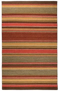 CLASSIC HOME cut-pile rug boasts bold stripes in fiery sunset hues, all made of pure wool. Classichomerugs.com