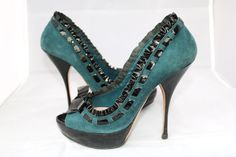Miu Miu Suede Black Platform Bow Ruffle Patent Open Peep Toe 37 Teal Pumps. Get the must-have pumps of this season! These Miu Miu Suede Black Platform Bow Ruffle Patent Open Peep Toe 37 Teal Pumps are a top 10 member favorite on Tradesy. Save on yours before they're sold out!