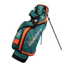 Miami Dolphins Stand Golf Bag is extremely lightweight, as well as comfortable to carry. Great features from include top, 5 location embroidery, 4 zippere Golf Stand Bags, Golf Bags, Nfl, Umbrella Holder, Miami Dolphins, Nassau, Sport Pants, Yoga Fitness, Golf Clubs