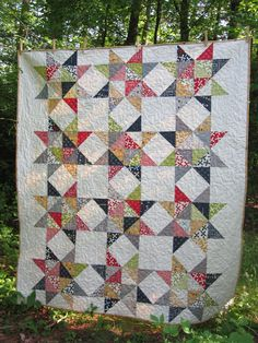 Reunion Stars Quilt -- red, blue, gray,  green, white, gold -- scrappy, modern, fresh -- lap or baby. $165.00, via Etsy.