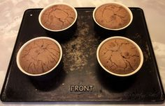Melt in the Middle Chocolate Puddings with raspberries.