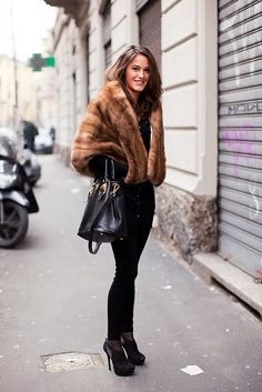 Cropped brown fur coat with all black skirt, tights and boots