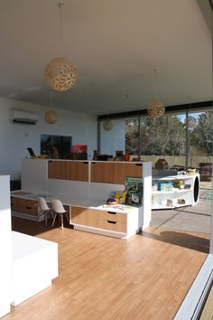 New Shoots Childrens Centre designed by Collingridge and Smith Architects. Custom designed and made flexible furniture modules delineate space.