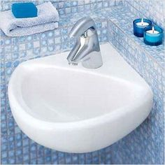 Save space and add convenience to your bathroom with American Standard's Corner Minette Wall Mount Sink. The Corner Minette Wall Mount Sink comes complete two wall hangers for easy installation and is designed to mount in a corner. The sink has a center h Space Saving Bathroom, Corner Sink Bathroom, Bathroom Ideas, Office Bathroom, Corner Bath, Bathroom Stuff, Bathroom Organization, Bathroom Storage, Commercial Bathroom Sinks