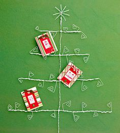 Everyone loves to display their Christmas cards and giving them a fun way to do it makes for a very thoughtful gift! More card displays: http://www.bhg.com/christmas/cards/christmas-card-display-ideas/?socsrc=bhgpin122113wiretreechristmascardholder&page=10