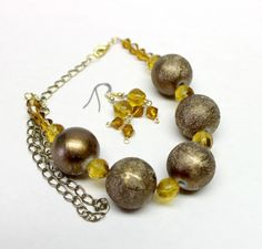 Textured brown bronze beaded necklace earrings faceted bicone amber beads
