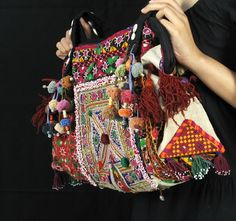 pompoms and tassles - add to curtains?  toss pillows? could add just the right touch for a bohemian camper