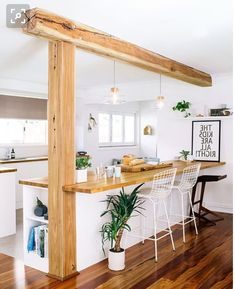 Would likely need to maintain a pillar at the end of a kitchen island for the flat - this would be the dream but it would probably be something less rustic in reality!