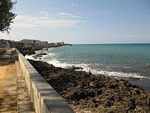 View along the Malecon (sea wall) of Baracoa