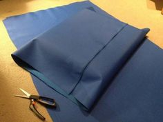Trim up the sides, leaving 2-3 inches of fabric peeking out from either side of the cushion.