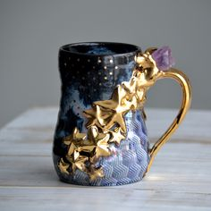 Another version of my golden star mugs phase. This is a new German 24k gold that I used. Holds around 18 oz. #pottery #mug #tea #coffee #crystalart