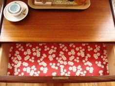 DIY drawer liners: wrapping paper with clear contact paper over it.