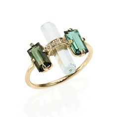 Baguette cut green tourmalines flank an arch of delicate diamond pave in this ring by Jacquie Aiche.Materials: 14K…