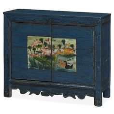 Constructed entirely of elm lumber reclaimed from rural Chinese villages, each panel is hand painted by master artisans. The design on its door panel takes inspiration from traditional Chinese water color painting, and features beautiful lotus flower pond where a charming family of ducks takes residence. The cabinet is framed in hand applied distressed blue  finish, adding a touch of character to any contemporary setting. One spacious double-door compartment provides ample storage space and…