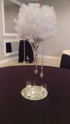 feather ball in martini glass with hanging crystals.                                                                                                                                                      More