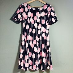 Black Dress w/ Pink Tulips & Pockets Maison Jules floral short sleeve dress. Black dress with pockets and a zipper closure. Worn once for 2 hours at a winery! In perfect condition. Please ask if you have any questions. Bundle & Save Maison Jules Dresses