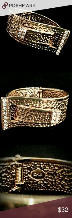 Kenneth Jay Lane Buckle Bracelet, 19 80's Vintage Absolutely Stunning bracelet; gold plated with clear crystal stones; hand hammered look; it looks like it came out of the box, perfect condition; spring hinge & KJL signature markings; hate to part with so price is firm. Kenneth Jay Lane Jewelry Bracelets
