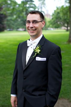 Classic Groom's Tuxedo with White Bow Tie and Green Orchid Boutonniere   Turnquist Photography   http://knot.ly/6497BxuFJ   http://knot.ly/6498BxuFK