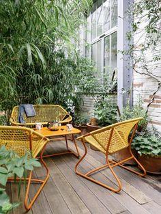 Retro yellow rattan style patio seating