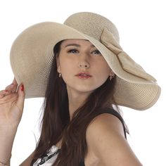 A Big Hat with a Bow. Perfect for sunny Summer days. Right now, only $48.
