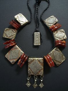 Berber Talisman Necklace ~ Faouzi Designs | even copper  silver Berber talisman prayer boxes representing the seven days of the week and also used for inserting verse and prayers with African carnelian Talhakimts used as spacers makes an incredibly interesting necklace