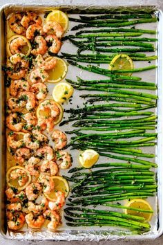 ONE PAN Roasted Lemon Butter Garlic Shrimp and Asparagus tossed with chili flakes and fresh parsley is not only bursting with flavor but on your table in 15 MINUTES! No joke! The easiest most satisfying meal that tastes totally gourmet. Stock up on froze Fish Recipes, Seafood Recipes, Cooking Recipes, Healthy Recipes, Recipies, Frozen Shrimp Recipes, Whole30 Shrimp Recipes, Easy Cooking, Cooking Food