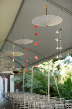 Unique use of paper umbrellas to liven up the interior or a tent. #parasol #weddingdecor #tentwedding